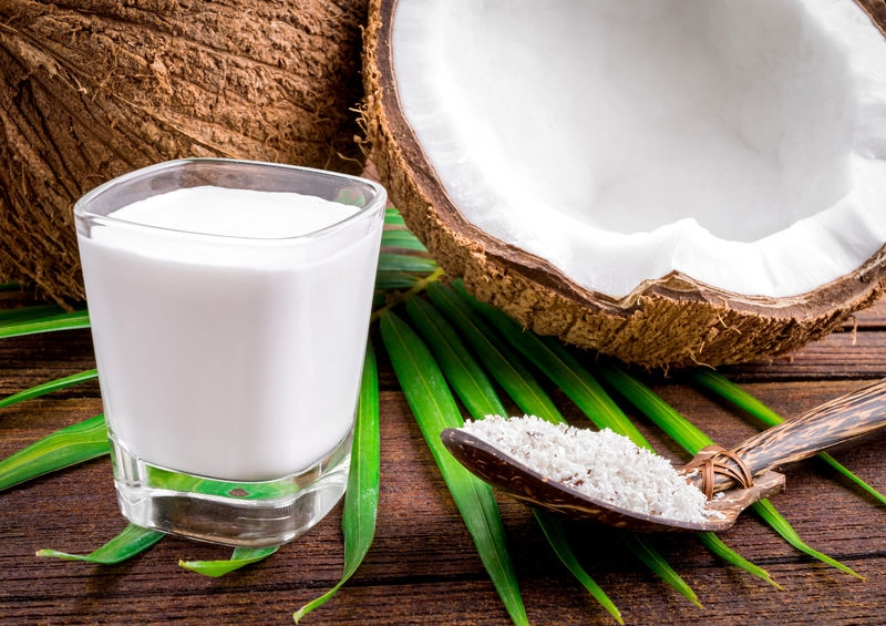 coconut and glass of coconut milk