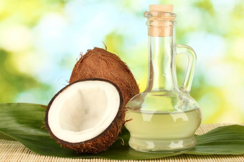 decanter with coconut oil and coconuts