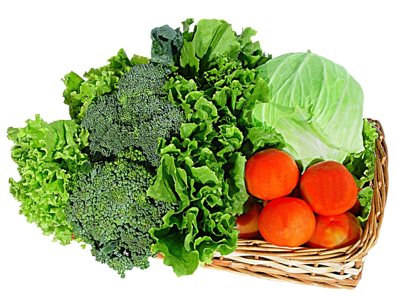Broccoli, lettuces, tomatoes, cabbage in basket