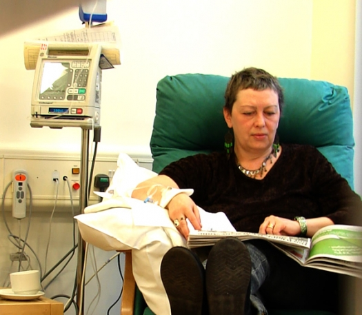 woman in chair receiving IV therapy