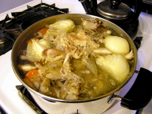 soup stock with chicken, onions, carrots