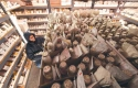 Person surrounded by bags and jars of seeds at the Seed Savers Exchange.